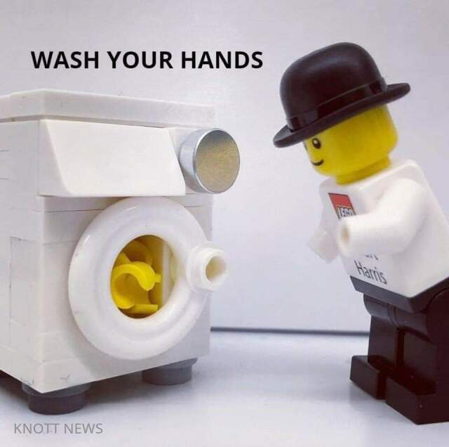 LEGO minifig with no hands, watching washing machine full of minifig hands